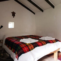 'The Oratory' bedroom which is in another small stone building across the kitchen yard